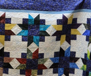 Sara had to finish the quilting on this quilt prior to her machine being sold.  She is upgrading and through the bee a new owner for her previous machine had been found.