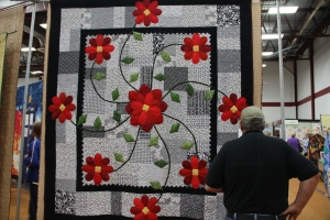 I love the poppies on this grey scale quilt.  (that is the hubby in the photo)