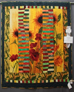 I love Stephanie Brandeburgs panels - I like how this quiltmaker broke up the panel.