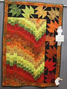 Great bargello quilt - love the addition of the leaves in the border.