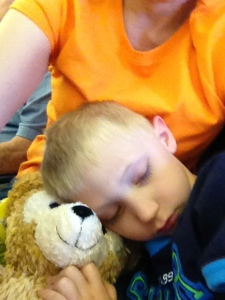 Asleep on Grandma's lap on the plane home!
