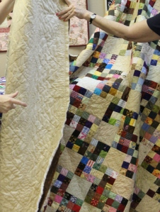 Cindy B is working on completing quilts for all the family members.  She uses a sit-down machine.