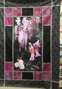 Beautiful quilt - her husband informed her she could not give this one away.  It will hang in their home.