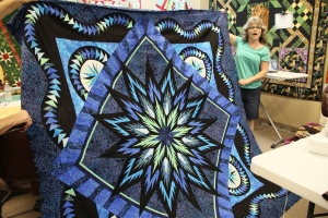 And another feathered star - Janeane added the queen  borders for Glacier Star to make this beautiful Feathered Star Quilt!