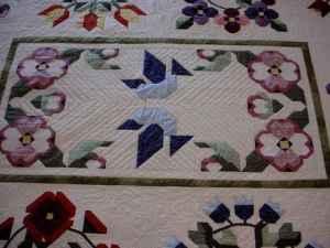 A pieced baltimore album quilt made by Susan's mom