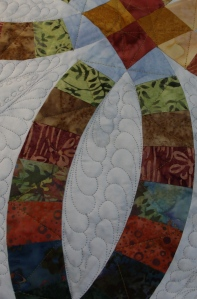 "On to the melon, that is the little ""football"" in between the pretty arcs.  Can you see the quilting in the arcs?  I decided there wasn't enough so I added some more!"