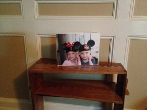 Hubby surprised me with this fabulous table, made by a young neighbor from recycled wood.  (Her original prototype for a school project was made from a pallet!)  And my son and his family surprised us with a wonderful photo album of memories from our trip to Disney World!