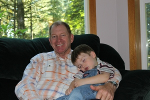 Bill being a granddad - nothing better than a sleeping grandchild to snuggle with!
