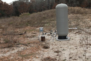 The next projects: bringing in the electricity from the road and then adding the well.  This well belongs to one of the neighbors.  We will be placing our tank in the barn - so the only parts I will need to disguise are the well head (the piece on the left).  I think planter boxes will work nicely!