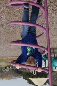 Cool photo - no he isn't upside down - grandpa had the camera turned that way - I would not have thought to rotate the photo!