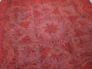 The back of the quilt - there really is quilting in those larger areas, the thread is red so you can't really see it here.