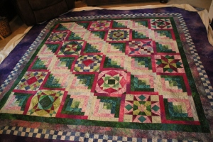 Sheryl's quilt is 36 blocks, an extra border (checkerboard) and her other borders a little larger than Sandy's 110x110