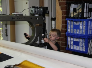 The scary part for grandma - he is actually running the machine and I am on the other side taking photos!