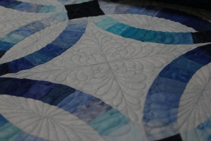 I love love love feathers in the wedding ring quilts!