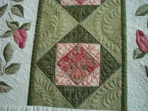 The green strips - traditional piecing with lots of feathers