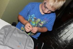 A grey apron for the boy!  NO RUFFLES!