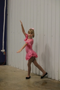 Posing - she wanted me to get her whole body including shoes!  Skates will be put on shortly!