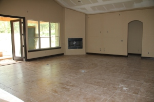 The great room with paint and tile, prior to masonry