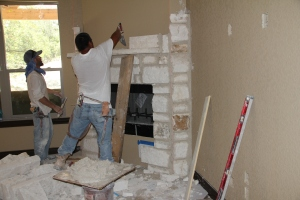 Mantel is set and they masonry continues
