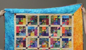 "Show and tell - this piecer was ""gifted"" more than a few tiny triangles from Nancy - she brought this beautiful quilt to show the guild and Nancy what she made with those tiny triangles"