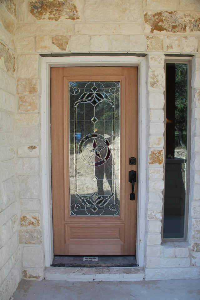 A little bit of stain and some trim paint and it will be very inviting.  You should see the doorbell - it is a Texas star too!