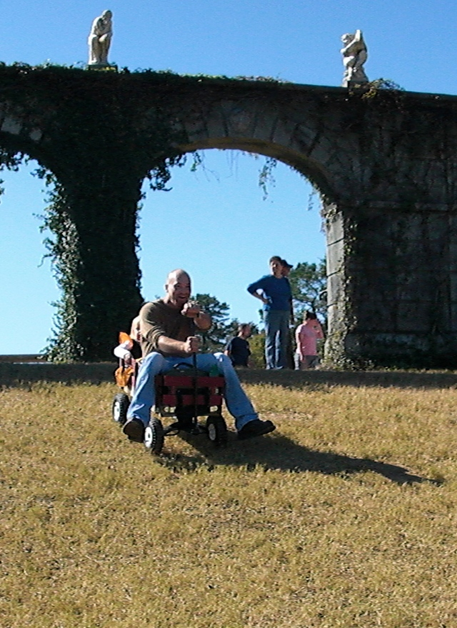 Look carefully - little toot is behind daddy and they are boogying down the hill in the wagon!