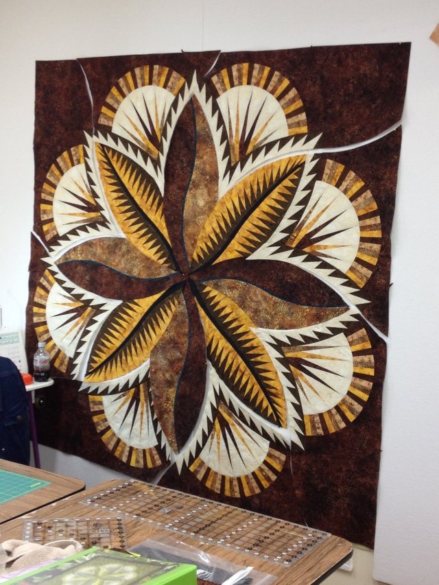 """Look - Lou Ann has all her center pieces on the board!  Pinwheels and Posies helped her select her fabrics - she told them she wanted it to look like """"leather"""" -"""