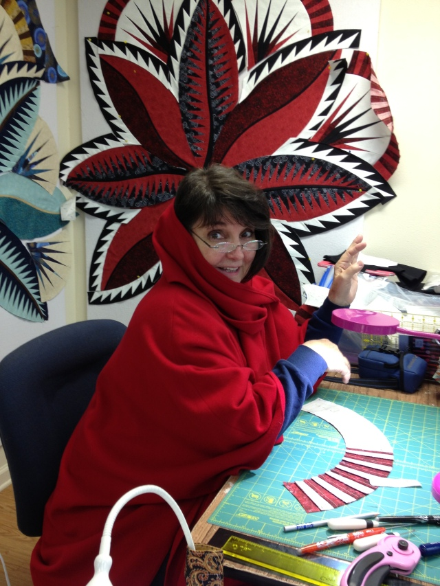 Some of you know how it goes at retreats - this person is hot, this person is cold - well we had little red riding hood here.  I think she just wanted to wear that scrumptious cape from Ireland!  PS - Diane is purchasing deflectors so each retreat can adjust there personal sewing zone!