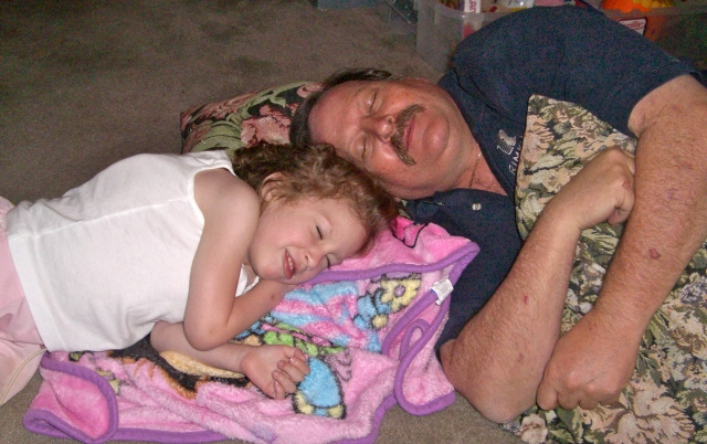 You and uncle Corey pretending to sleep - you and he would hang out every night when he got home from work!
