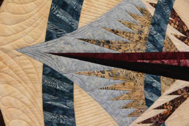 "These are the sails.  I created ""billows"" with the quilting."