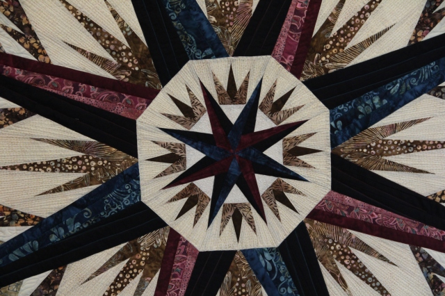 Another view of the compass rose with more of the other piecing, see how the spokes radiate out from here?
