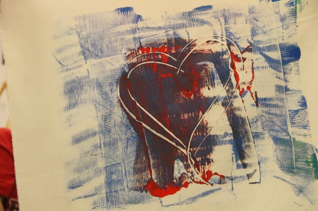 but once she rolls the pair the red is no longer dominate - she she drew a heart - the is fabric after transfer
