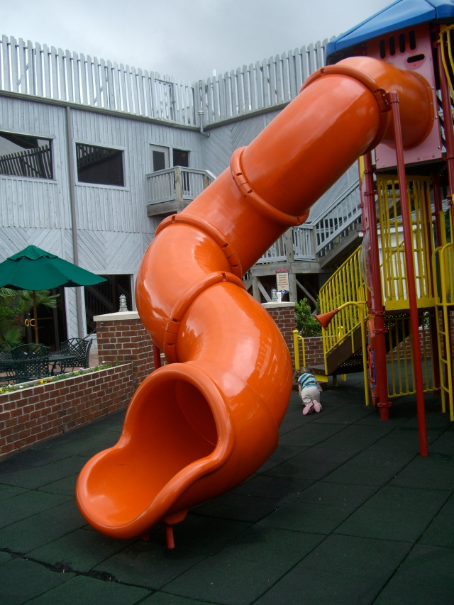 Look towards the back of the slide - you are heading off to climb the stairs to slide down the slide - you got scared half-way down and Sue had to slide down to rescue you!