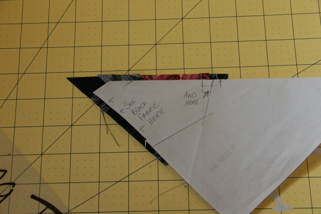 "This photo shows you where you should see your fabric ""under"" the paper to know you have placed it properly."