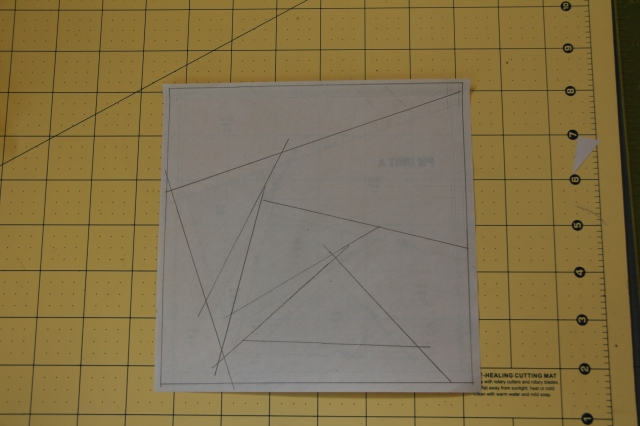 Prior to starting the next step it is recommended that you place your sewing paper on a light box (or window) upside down, trace the DASHED lines on to the back of the paper.  (If you are experienced with paper piecing this step may be skipped.