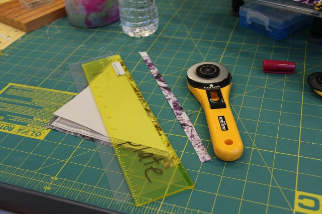 Use your add-a-quarter ruler and trim away the excess accent fabric.