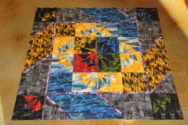 This is the quilt we are making!  My sample block is the one in the lower left corner.