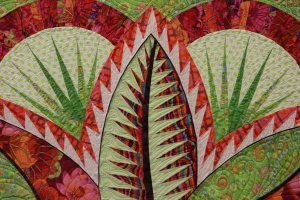 Quilting Photos! - See the dark outline around her leaves?  That is piping!!!