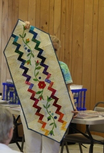 This Show and Tell is our CRUISE QUILT!!! Quilted and Bound with Applique!
