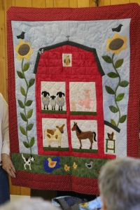 And this adorable barn quilt for a young child - when I grow up I want to needle turn like that!